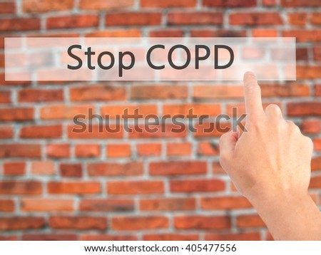 Stop COPD - Hand pressing a button on blurred background concept . Business, technology, internet concept. Stock Photo - stock photo