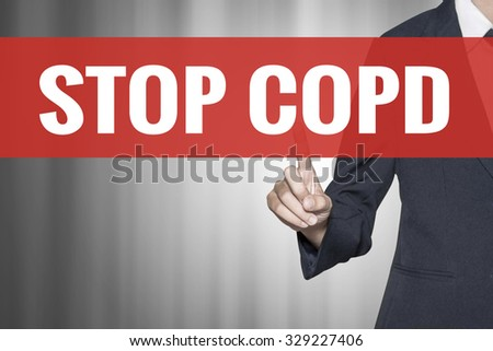 Stop COPD word on virtual screen push by business woman red tab - stock photo