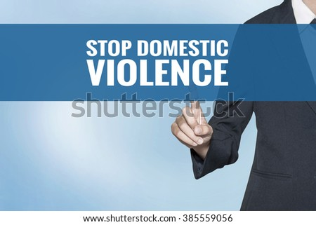 Stop Domestic Violence word on virtual screen touch by business woman blue background - stock photo