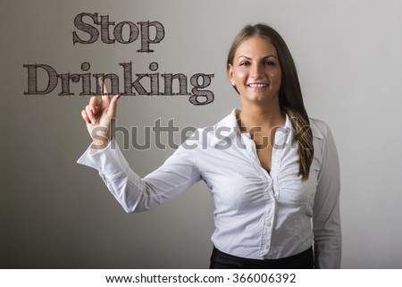 Stop Drinking - Beautiful girl touching text on transparent surface - horizontal image