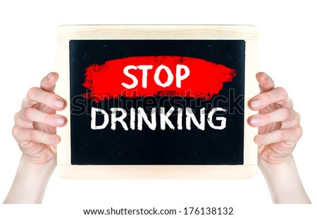 Stop Drinking. Creative composition with the message Stop Drinking woman hold on blackboard - stock photo