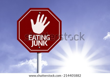 Stop Eating Junk red sign with sun background  - stock photo