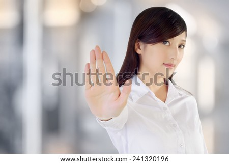 Stop gesture by confident business woman, closeup portrait. - stock photo