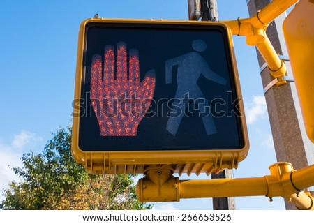 Stop light for pedestrians on Manhattan - stock photo