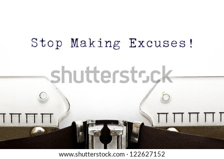 Stop Making Excuses printed on an old typewriter