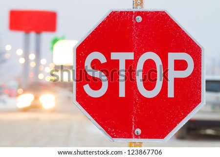 Stop road sign in snowy day in winter. Canada
