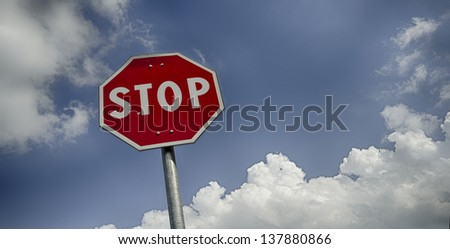 Stop road sign with clouds and free space for text