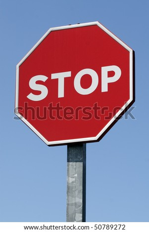 Stop sign. A stop sign against a bright blue sky