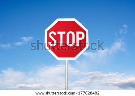 Stop Sign and blue sky - stock photo