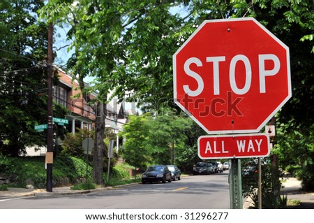 Stop sign at an intersection with a street in the background