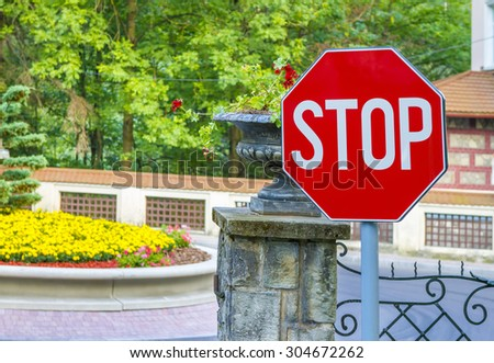 Stop sign closeup with woods and fence in the background - stock photo