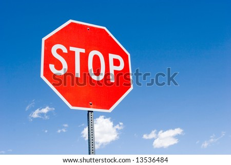 Stop sign for traffic against blue sky