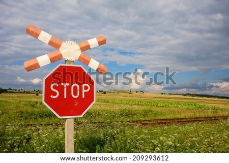 Stop sign in front of the railway - stock photo