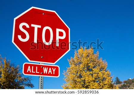 Stop sign in the autumn