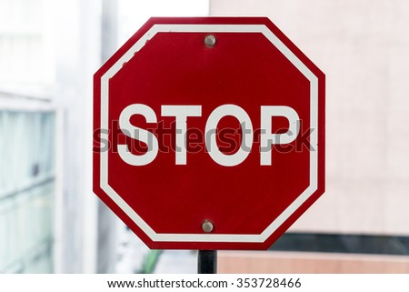 stop sign on big city and building background