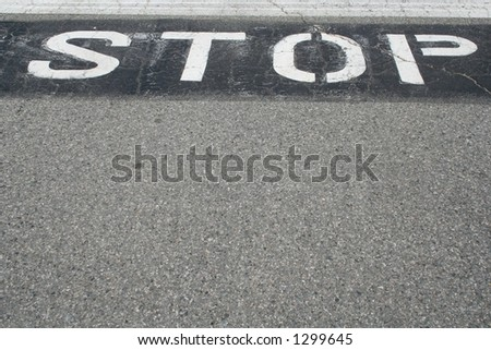 Stop Sign on Pavement - stock photo