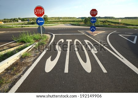 Stop sign painted on the road - stock photo