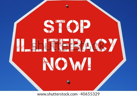 "stop sign reading ""STOP ILLITERACY NOW!"""