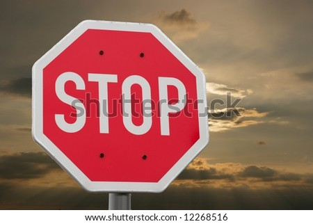 Stop sign with dramatic sky in the background - stock photo