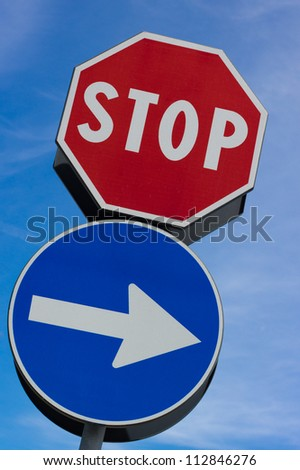 Stop signal with right arrow in blue sky