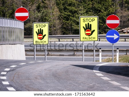 stop signs - wrong way - in austria at a highway