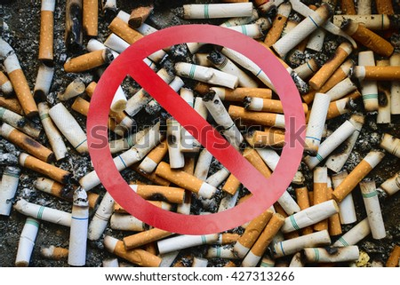 Stop smoking and many dirty cigarettes butts background - stock photo