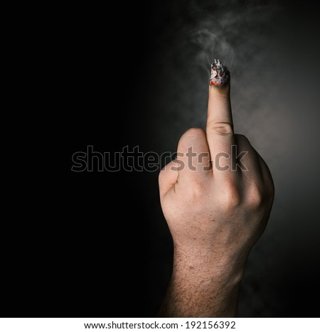 stop smoking concept. cigarette like a middle finger - stock photo