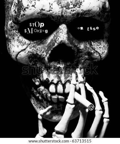 stop smoking or else- written in the eye sockets of a skull smoking a cigarette - stock photo