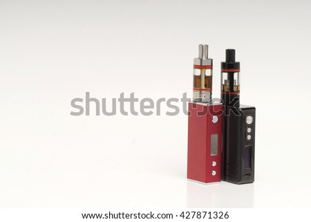 Stop smoking, start vaping. A red and black vape or electronic cigarette placed on the right on a shaded white background. Room for text on the left. - stock photo