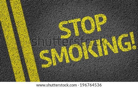 Stop Smoking written on the road - stock photo