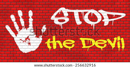 stop the devil no evil or sinning graffiti on red brick wall, text and hand - stock photo