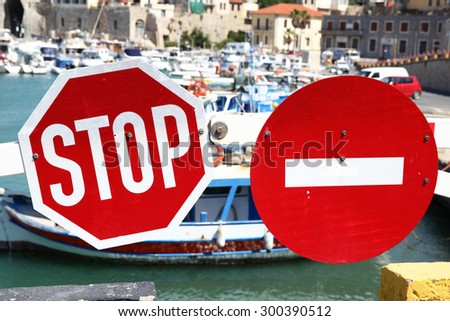 Stop traffic and No Entry signs on the barrier - stock photo