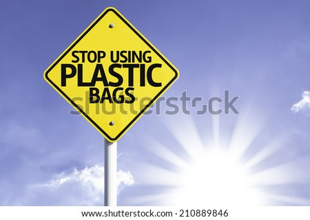 Stop Using Plastic Bags road sign with sun background - stock photo