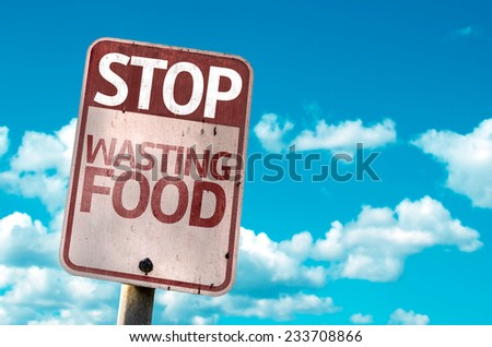Stop Wasting Food sign with sky background - stock photo
