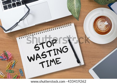 Stop Wasting Time Tablet with blank black screen and coffee cup - stock photo