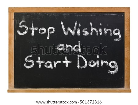 Stop wishing and start doing written in white chalk on a black chalkboard isolated on white