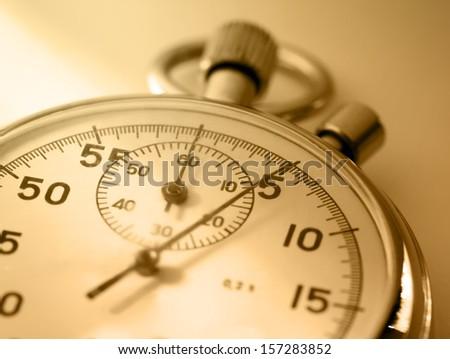Stopwatch closeup in sepia toning - stock photo