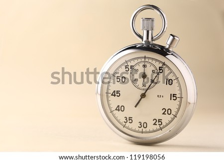 Stopwatch closeup on beige background - stock photo