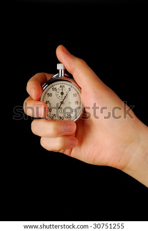 Stopwatch in female hand, isolated on black