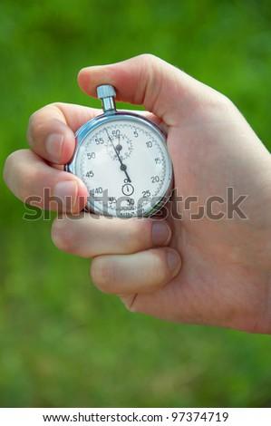 stopwatch in hand - stock photo