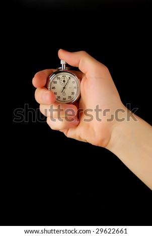 Stopwatch in male hand, isolated on black - stock photo