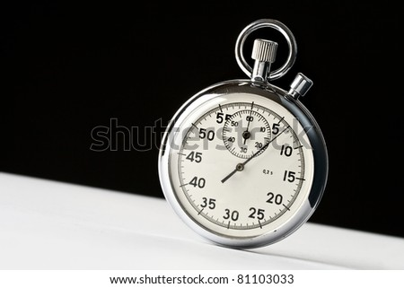 Stopwatch on black and white background - stock photo
