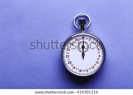 Stopwatch on blue background, close up - stock photo