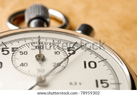 Stopwatch on paper background - stock photo