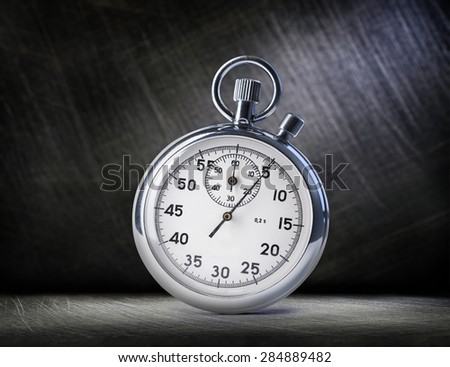 Stopwatch on steel scratchy background in light - stock photo