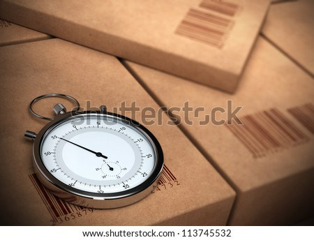 stopwatch over a carton background with barcodes. blur effect. - stock photo