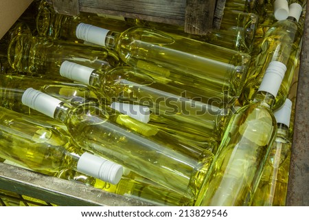 Storage box with white wine bottles - stock photo