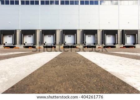 Storage entrances, new large warehouse - stock photo