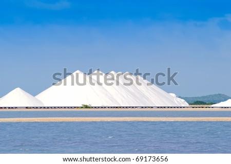 Storage hills of sea salt against salt pans of Bonaire - stock photo