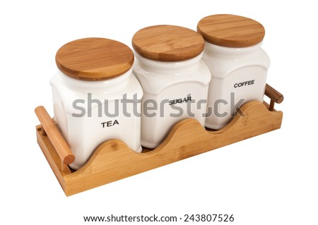 storage jars tea coffee sugar on a wooden stand isolated on white background - stock photo